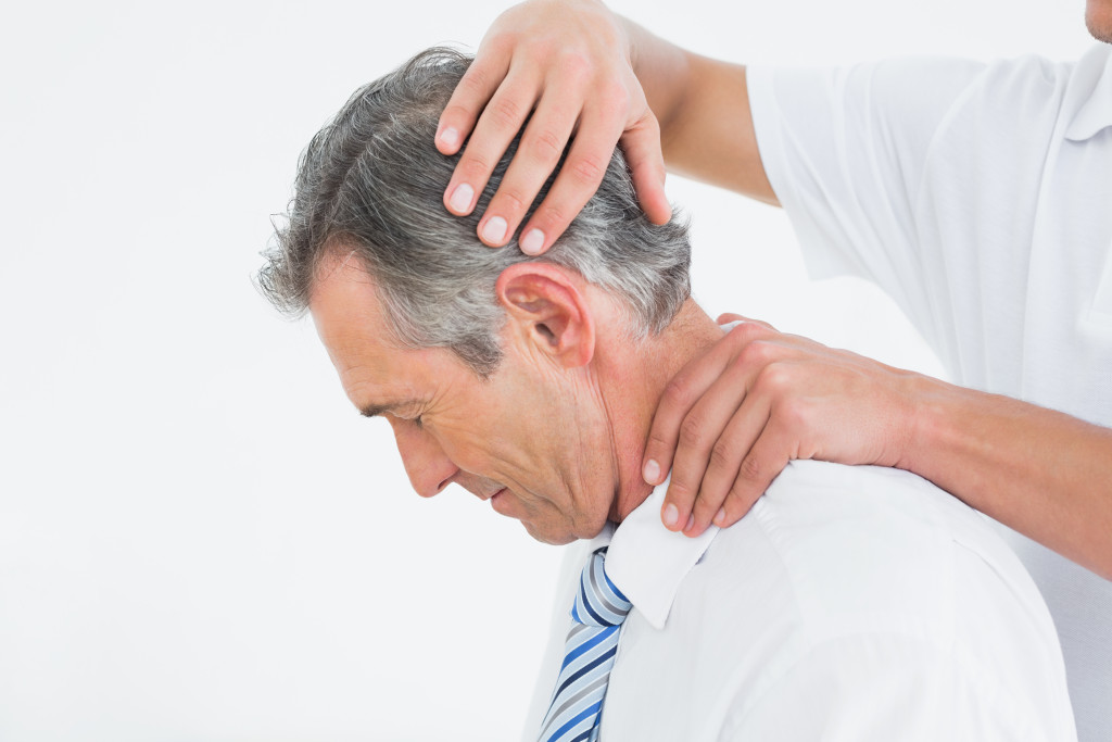 Side-view-of-chiropractor-doing-neck-adjustment